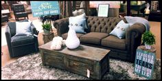 """Tuft chocolate brown couch with teal and black accents. Rustic sign """"I laugh so hard, tears run down my legs!'"""