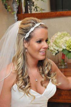 wedding hair half up with flower and veil | 30 Sexy Half Up Half Down Wedding Hairstyles | CreativeFan