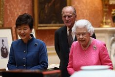 The President of the Republic of Korea Park Geun-Hye (L), Prince Philip, Duke of Edinburgh (2nd-L) and Queen Elizabeth II look at an exhibition of Korean related items from the Royal Collection and Royal Archives in the Picture Gallery of Buckingham Palace on November 5, 2013 in London, England.