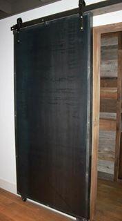 Metal barn door with wood frame.