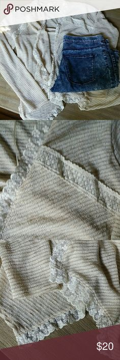 Lacey cardigan Tan and cream flowy cardigan with lace accents. New without tags! Somehow managed to get a small snag close to the bottom of the cardigan but took me awhile to even realize it was there ! Other than that it's in perfect condition. Monteau Sweaters Cardigans