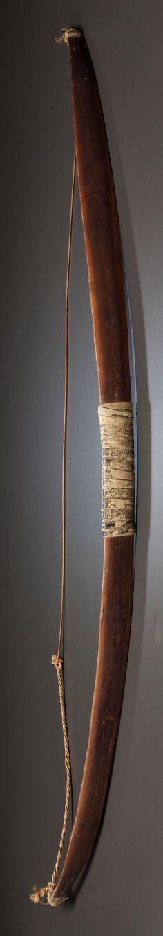 A PLAINS PAINTED WOOD AND SINEW-BACKED BOW. c. 1860... American | Lot #50240 | Heritage Auctions
