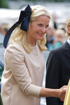 Princess Mette-Marit of Norway in a giant ribbon headband