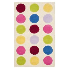 Artfully hand-tufted from New Zealand wool, this eye-catching rug showcases a multicolor polka-dot motif laid over any ivory backdrop.