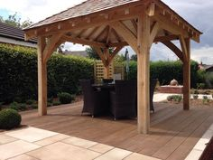 After photo - the stunning bespoke oak gazebo with cedar shingle roof on a square deck of Millboard enhanced grain composite decking in 'coppered oak' - what a wonderful setting for dining & entertaining! The gazebo also has lighting & electric sockets