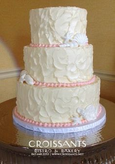 Tiered Beach Wedding Cake with Pink Pearl Dot Border