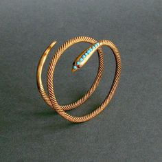 Antique snake bracelet with turquoise head and garnet eyes. Circa 1905 Egyptian silver with a gilt finish.