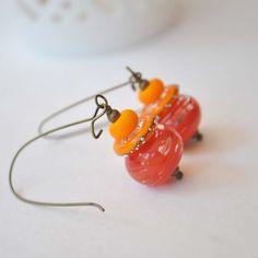 A personal favorite from my Etsy shop https://www.etsy.com/listing/207322623/orange-earrings-lampwork-earrings-glass