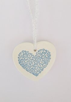 A cute handmade clay heart decoration, perfect for Christmas tree decoration, or every day. Imprinted with a heart design. Perfect for hanging on