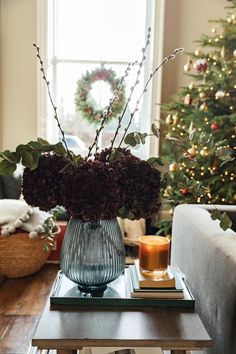 Large dried burgundy hydrangeas in a blue glass vase from H&M Home Blue Glass Vase, Eucalyptus Garland, Dried Oranges, H&m Home, Tree Lighting, Time To Celebrate, Christmas Love, Hydrangeas, Christmas Tree Decorations