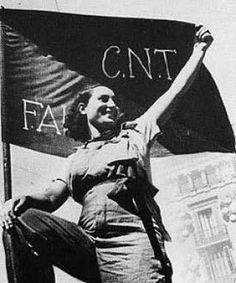holding up the flag of a major anarcho-syndicalist group