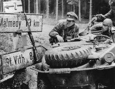 Joachim Peiper aboard a Schwimmwagen outside of Malmedy. Ardennes Offensive - 1944