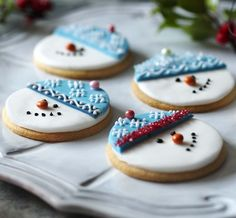Our step-by-step guide to making these cute snowman biscuits. A great Christmas treat for children.