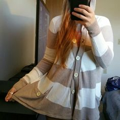 Free People striped boho hoodie sweater Comfy and warm Free People hooded sweater, normal wear and pilling,  very bohemian and loose fitting with flared body  60% Cotton 30% Nylon 10% Wool Free People Sweaters