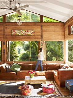 Love the wood and high celings... and the enormous leather couch that screams for lazy Sundays!