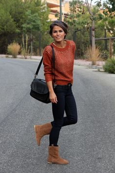 Dark skinnies, flat boots, mesh pullover sweater with white tank.