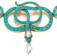 Detail: 19th century turquoise, ruby, and pearl snake necklace. Via Diamonds in the Library.