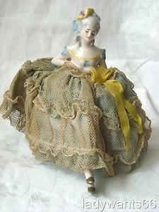 VINTAGE PRETTY LADY HALF DOLL ON PIN CUSHION BASE WITH PORCELAIN LEGS