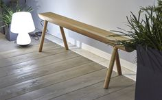'Stick Bench' in solid teak for indoor/outdoor use. We love the asymmetrical arrangement of the legs supporting this half-tree trunk. We hope to get this in-store Spring 2016. rrp £400.00