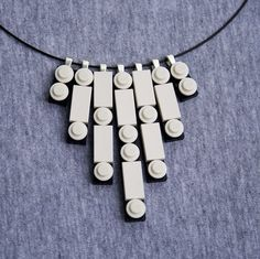 Great idea for a lego necklace.