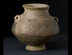 Vessel with stylized sun and moon decoration. Early Bronze Age 3.a Budapest History Museum