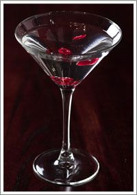 SKINNY GIRL WHITE CRANBERRY COSMO - shaken over ice and served in a martini glass with a garnish of dried cranberry.