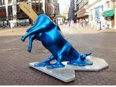 """""""The Melting Cow"""" statue. The blue Ice-Cream Cow melting into the hot summer pavement in Budapest, Hungary. If you imagined a cow as ice-cream, where would you have to insert the wooden stick Exactly. On the stick it says """"Don't Lick. Funny Dog Photos, Funny Dog Videos, Funny Pictures, Cow Parade, Expos Paris, American Funny Videos, Instalation Art, Alexander Calder, Art Sculpture"""