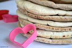 Heart shaped pita chips for Valentine's Day. A cute and healthy snack.  Serve with roasted red pepper hummus