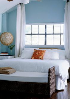 These pieces lend a crisp, updated look to freshly painted celery green walls used as background to white bedding and painted trim.