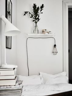 Black And White Minimalist Bedroom. Love The Small Shelf And Hanging Light  Fixture.
