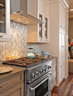 Same kitchen I love.  Unique backsplash, cabinet colors (upper & lower) & what looks to be possibly soap stone or concrete counters?  Perfection.