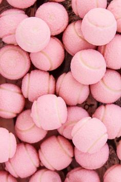 Pink pastel tennis balls -- the stuff that cotton candy dreams are made of!