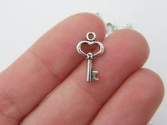 436400a5bd93 Buy Now 16 Key charms antique silver tone K41 by nicoledebruin. Infancia