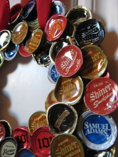 I could make a beer cap wreat and hang it in the garage!! Great for my boyfriend to do with the caps he collects
