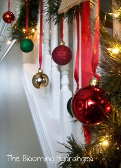 Christmas bulbs hung with ribbon - my cat will have a blast with this!
