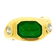 Boucheron emerald and diamond ring, French, circa 1940. | From a unique collection of vintage cocktail rings at http://www.1stdibs.com/jewelry/rings/cocktail-rings/