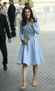 Kate midletone in a light blue dress/coat