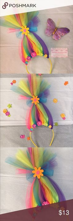 Rainbow Troll Hair Headband Neon rainbow tulle and multi colored flowered make this unique troll hair headband a colorful and fun gifts. These pieces are custom and made to order, message me for requests and available styles and colors. Also listed on my etsy shop Accessories Hair Accessories