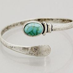 New! Burnished silver tone spiral cuff bracelet with reconstituted turquoise bead. Bundle and save 15%. No trades. 2.25 inch diameter.