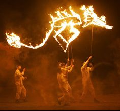 Fire! Fire? Can we have fire breathers/fire dancers? Fire puppets for the parade? Firefly?  Woodford Festival
