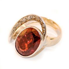 White gold ring with garnet rodolite and natural brown diamonds