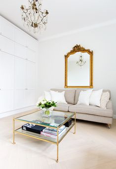 Alexa Dagmar Office with neutral sofa and glass gold coffee table