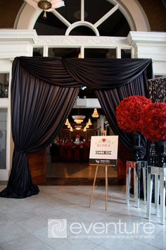 Grand Entrance with Black Drapery and Red Rose Arrangements on Mirror Pedestals – shared by Eventure