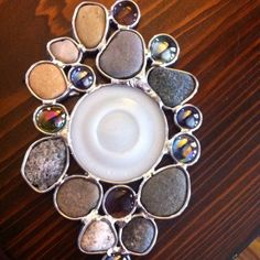 Rocks, zinc canning lid and baubles soldered together using lead caming.