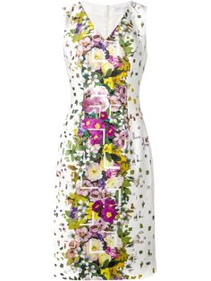 Adorned with a multicolored floral-print, this stretch-cotton dress from Carolina Herrera is a statement style. Designed to draw the eye to the narrowest part of your silhouette, this knee-length dress is a figure-flattering way to brighten up your wardrobe. Wear with pared-down accessories to let the colorful pattern steal the spotlight.