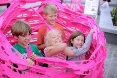 """'Bloom' is an interactive urban play structure commissioned for the London Olympic and Paraolympic games in 2012, in their signature shocking pink.  It is a social sculpture–""""a playground formed by players""""–that requires engagement for its formation. A single fabricated piece bears three connections that allow the construction of a ring, a spiral, or a - Read the rest..."""