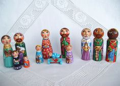 Christmas nativity set Holy Family Three Kings painted wooden scene creche crib angel baby Jesus Christ Joseph Mother Mary peg doll figurine colorful folk art child birthday birth christening baptism holiday communion gift present red souvenir keepsake heart snow manger figure holy night Virgin shepherd toy decoration stable sheep religious shed girl Madonna star Three Magi Wise Men