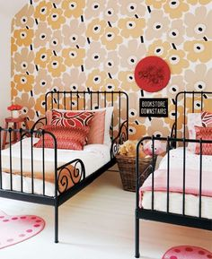 Love the black iron framed beds for boy/girl room