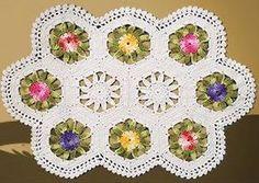 Receitas Círculo - Tapete Cru com Flores Coloridas