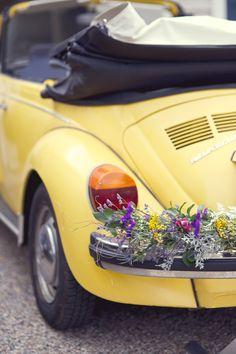 1976 Yellow, convertible VW beetle´s buffer-bar (bumper bar) decorated with flowers (Florist : Greenlion Design) - Westport Casual Elegant Wedding from Lens Cap Productions